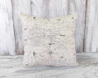 Throw cushion with world map and airplanes in cream and grey - for home decor, nurseries, gifts