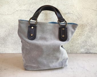 Made in Italy small suede bucket tote by Maurizio Taiuti in light blue gray