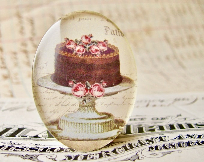 From our Bountiful Bakery collection, chocolate cake with pink roses, glass oval cabochon, handmade, 40x30mm, vintage kitchen, flowers