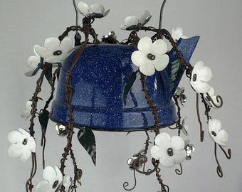 White Forever Blooming Plant In Old Blue Enamel Teapot