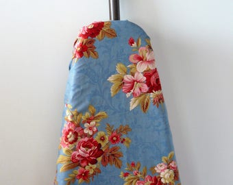 Ironing Board Cover beauiful bouquet of pinkish red and brown toned flowers on a washed denim coloured background