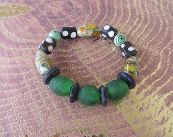 Tribal Inspired Stretch Bracelet With Ghana Glass Carved Bone Magnesite And Glass Beads