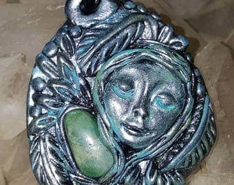 One of a kind hand sculpted Wild Woman Goddess mounted with Genuine Mojave Turquoise  Gemstone.