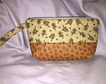 Wristlet zipper bag with 2 coordinating fabrics and attached crystals