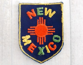 """Used Vintage 2.6"""" Sew On New Mexico Travel Patch, Zia Sun Symbol Applique, Embroidered Souvenir, Land of Enchantment Collectible"""