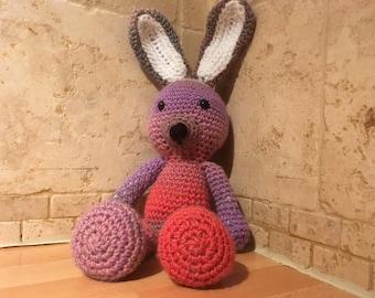 Multi-coloured rabbit doll