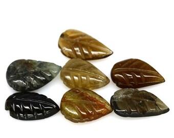 TOURMALINE (35774) -   PARCEL  (7 Stones) Hand Carved Tropical Tourmaline Leaf