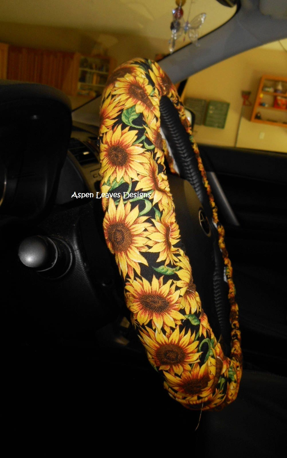 sunflower steering wheel cover gold metallic sunflowers with leaves on black seat belt covers. Black Bedroom Furniture Sets. Home Design Ideas