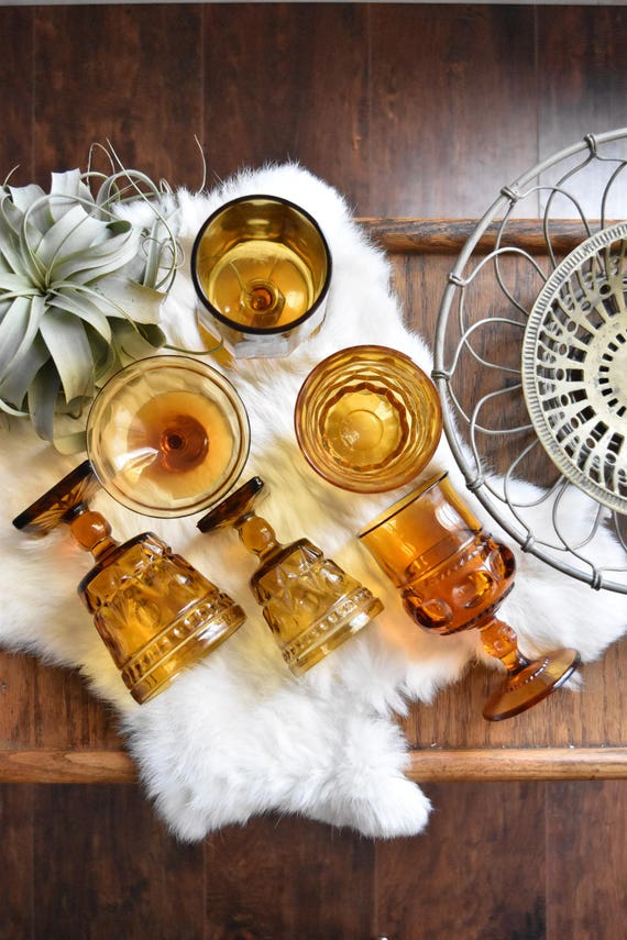 mix collection of amber glass champagne wine glass goblets / depression glass set