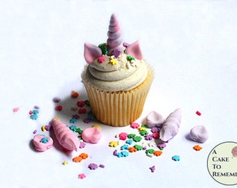 12 edible  unicorn cupcake toppers for unicorn party ideas. Unicorn horn, ears and sprinkles set to decorate unicorn birthday cupcakes.