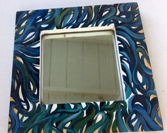 Mirror with vine painted frame