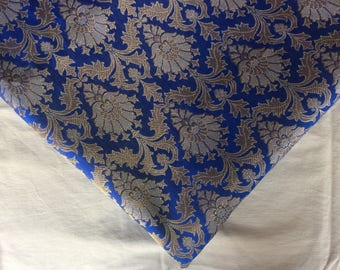 One yard of Indian brocade fabric in blue with dull gold in a regal pattern