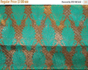 15% off on Half yard of Indian brocade in green and coppery gold