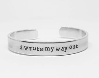 I wrote my way out: Hand Stamped Aluminum Hamilton Musical quote cuff by fandomonium