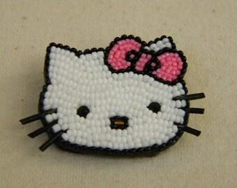 Hello Kitty pin.