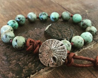 Sea green turquoise bracelet with a silver sand dollar clasp