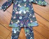 Baby tunic set -sewn in a cotton knit with matching leggings in a navy/teal print with white bunnies and flowers.