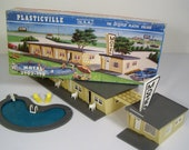 Kitschy Mid Century Modern Plasticville Motel with Pool. Motel Office with Vacancy Sign. 6 Chairs. Diving Board and Ladder. Drive up Canopy.