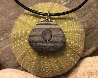 Sea glass jewelry- purple sea glass set in a beach stone.