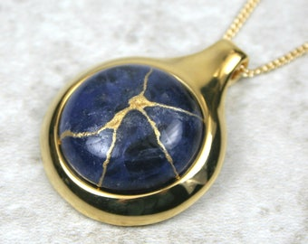 Kintsugi (kintsukuroi) sodalite stone cabochon with gold repair in a gold plated setting on gold chain - OOAK