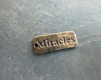 Pure Bronze Miracles charm 17mm x 7mm oxidized finish artisan style bracelet charm word charm hammered finish dog tag style