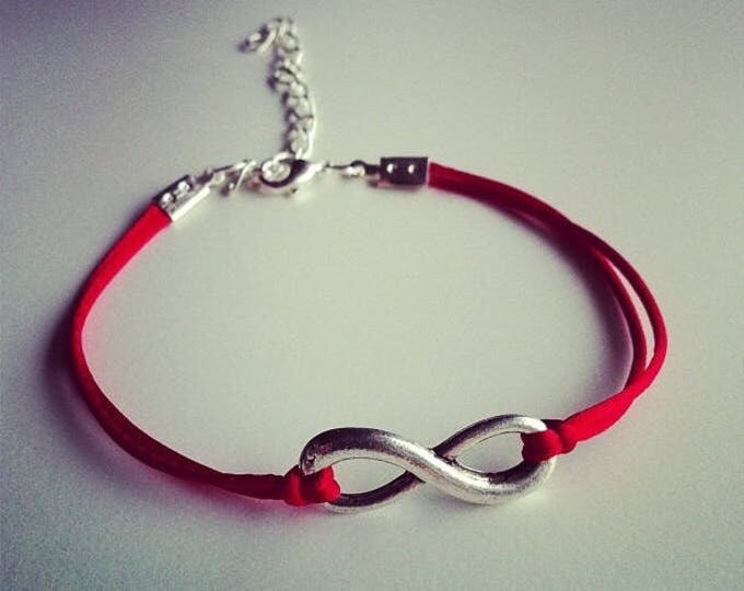 Red cord with silver infinity sign bracelet