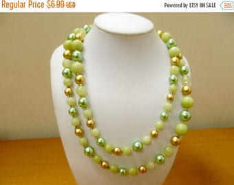 ON SALE Vintage Very Long Shades of Green and Gold Plastic Beaded Necklace Item K # 1130