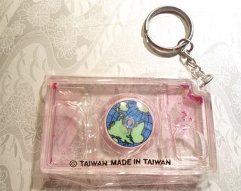 1 Plastic Spinning World in Water Key Ring Key Chain