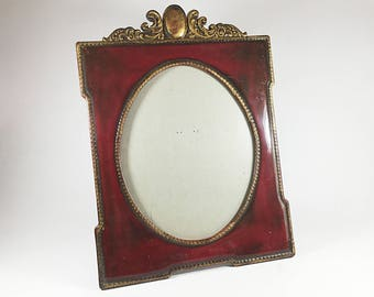 Vintage photo or picture frame, Red Maroon Burgundy Gold colour plastic, Oval shape, Ornate scroll top, Beaded edge Stand up table top frame