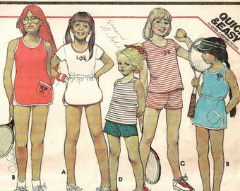 "A Set of Tennis Dresses Sewing Pattern - Dresses or Tops and Shorts - Includes New Transfer: Girls Size 12, Breast 30"" • McCall's 5549"