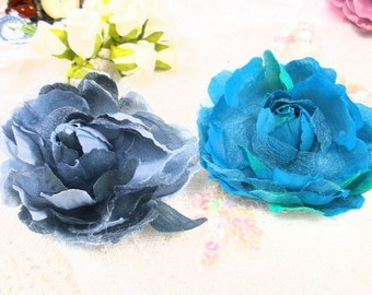 2 large blue/gray fabric flowers