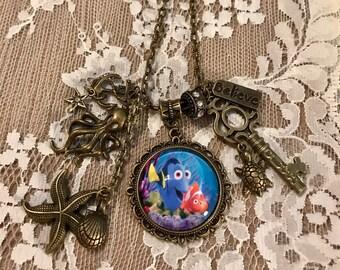 Antique Bronze Tone, Pendant Necklace With Charms, 'Dory And Nemo'.  Antique Bronze Tone.