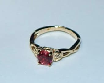 Ruby with diamonds in 14k gold ring, about size 6.5.  More info to come