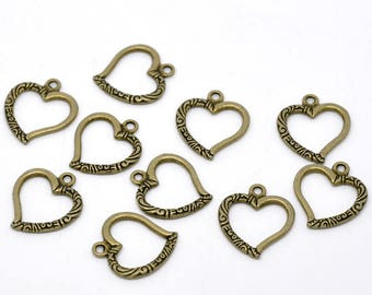finely decorated and openwork bronze metal hearts 10 25mm