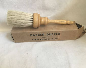 Vintage Barber Duster in original box. Beautiful wood turned handle with natural bristles sold by Sears Roebuck & Co 9298
