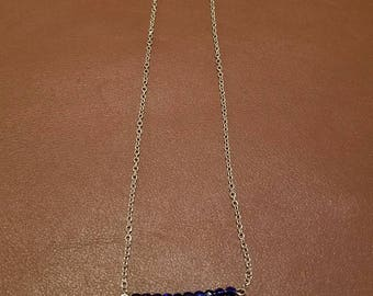 Royal blue and feather charm necklace