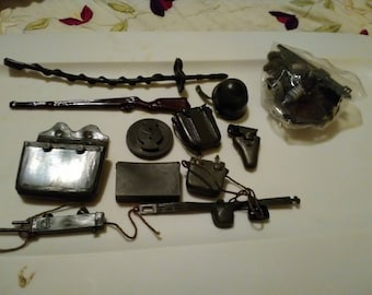 G I Joe 11 pieces of rifle, gun in holster, ammo belt. See picture.