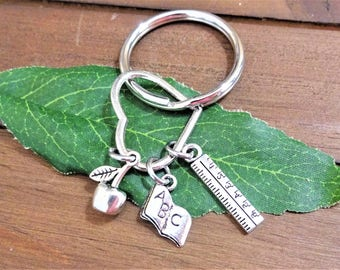 """TEACHER KEYCHAIN on a heart with ruler, apple, book charms- Read """"item details"""" & see all photos - one flat rate shipping in my shop :)"""