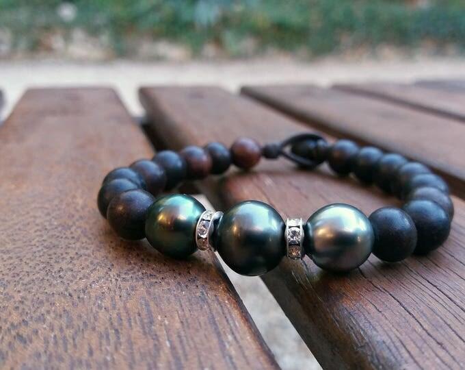 Tahitian Pearls, woman bracelet. Three tahitian pearls surrounded by rhinestones in cristal svarowski and dark brown wood