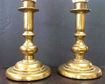 Colonial brass candle holders