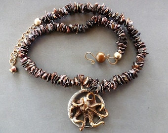 Bob Burkett-designed bronze octopus on sterling silver pendant; bronze Keishi pearls with gold pearl hook, chain, and brushed gold beads.