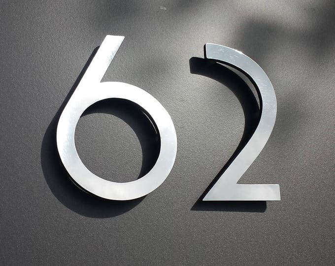"Polished aluminium 3D 6"" high house serif numbers in Grenadier font,   marine lacquered with floating standoff g"
