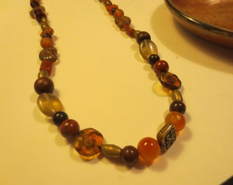 Brown and gold necklace with lots of Czech glass