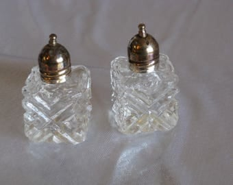 """Vintage crystal glass """"X"""" mini salt and pepper shakers with copper tops, made in Japan"""