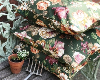 A vintage Sanderson linen bench cushion cover