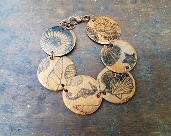 Handmade salvaged copper round bracelet with seashell ocean nautical design