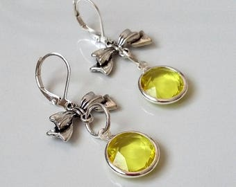 Earrings with bow and synthetic yellow crystal