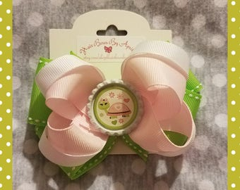 Pink and green hair bow with Turtle embellishment