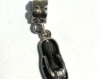 1 silver charm black tong with Rhinestones and bail size: 36 mm X 09 mm thickness: 5.5 mm