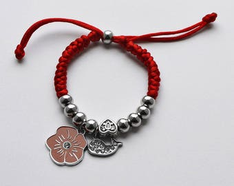 Adjustable red bracelet with charms (R1)